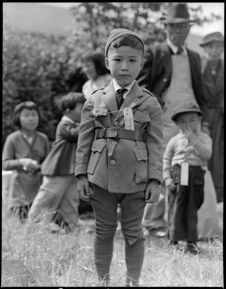 Centerville, California. This youngster is awaiting evacuation bus. Evacuees of Japanese ancestry . . .