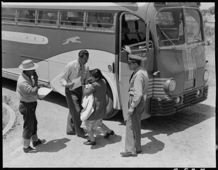 Stockton, California. Young mother of Japanese ancestry has just arrived at this Assembly center wi . . .