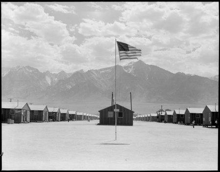 Manzanar Relocation Center, Manzanar, California. Street scene of barrack homes at this War Relocat . . .