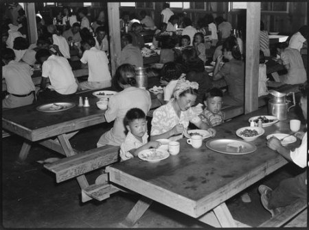 Manzanar Relocation Center, Manzanar, California. Mealtime in one of the messhalls at this War Relo . . .