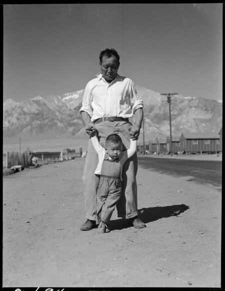 Manzanar Relocation Center, Manzanar, California. Grandfather of Japanese ancestry teaching his lit . . .