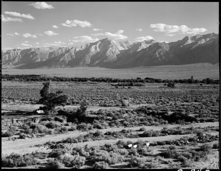 Manzanar Relocation Center, Manzanar, California. A view of surrounding country flanked by beautifu . . .