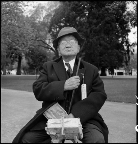 Hayward, California. Grandfather of Japanese ancestry waiting at local park for the arrival of evac . . .